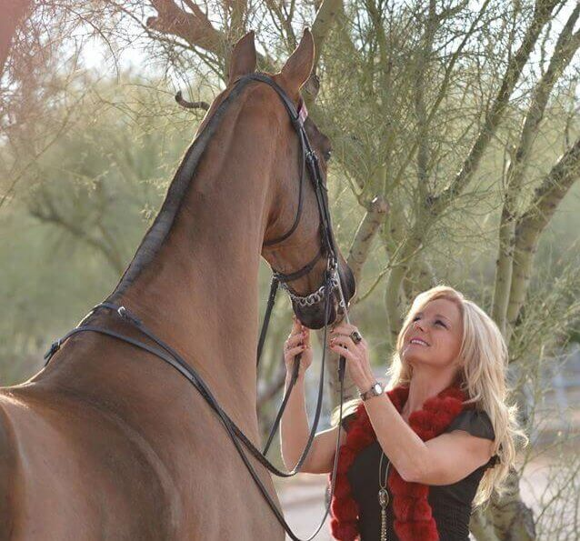 Riding Lessons in North Scottsdale Image of Michelle Mcvey Haisch On Desert Palms